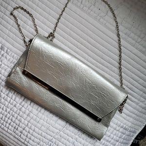Metallic Silver clutch with crossbody chain